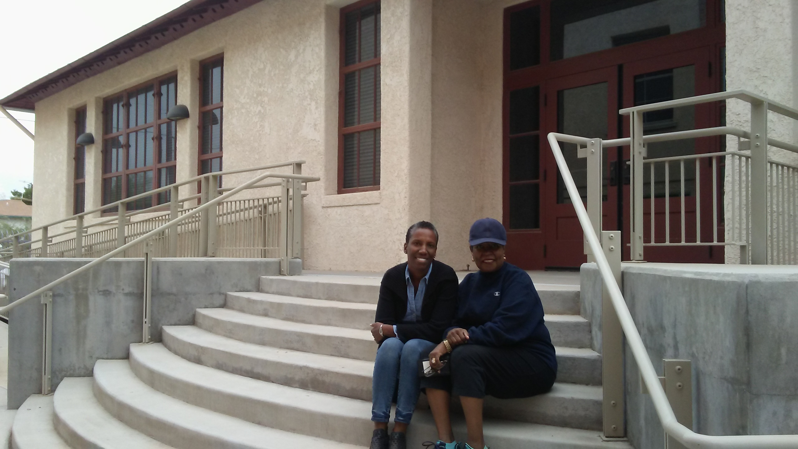 SBS Community Impact Fellow Debi Chess Mabie and Chyrl Lander on the steps of the Dunbar Pavilion