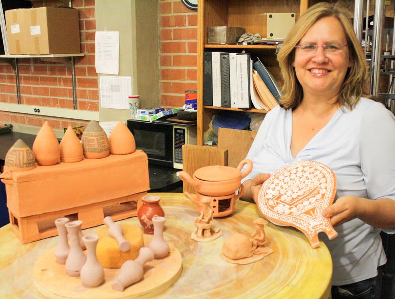 Eleni Hasaki with pots