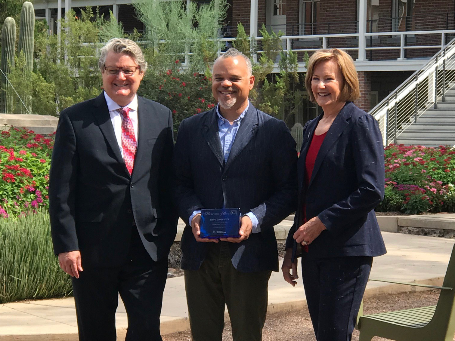SBS Alumnus of the Year Dave Schechter (center) with John Paul Jones III, dean of the College of Social and Behavioral Sciences, and Melinda Burke, president of the UA Alumni Association.