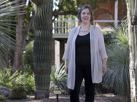 Elizabeth Baldwin at the University of Arizona campus by a sagauro.