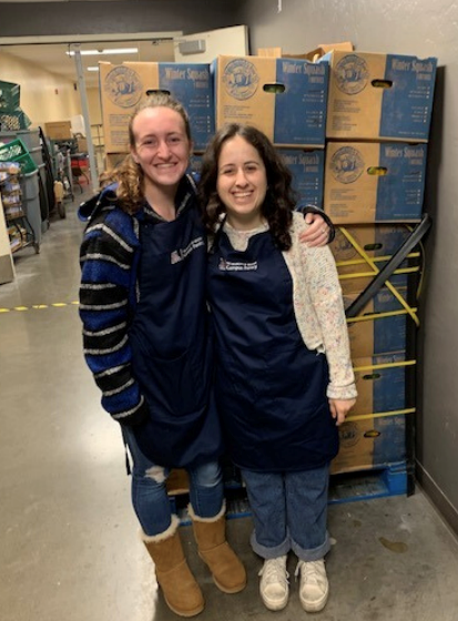 Michaela Davenport (right) with other female student working at the Campus Pantry