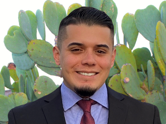 Patrick Robles in front of cacti