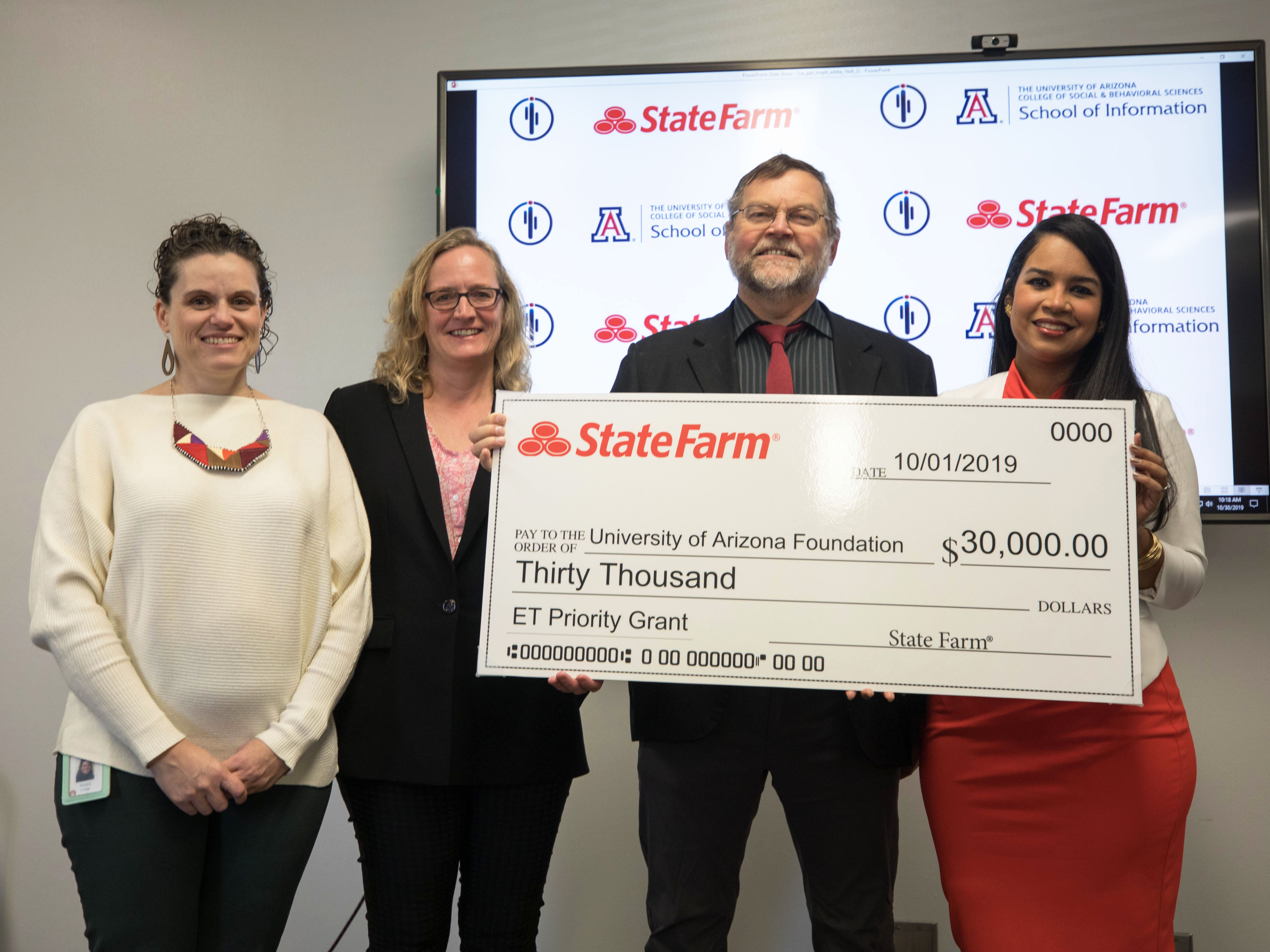 ): Kendra Davey, Literacy Initiatives Program Manager with the Pima County Public Library; Catherine Brooks, director of the University of Arizona School of Information; Bryan Heidorn, professor in the iSchool; & Annie Frits, State Farm agen