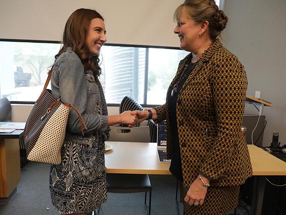 Student Alex Slater meets T VanHook, CEO of Habitat for Humanity Tucson