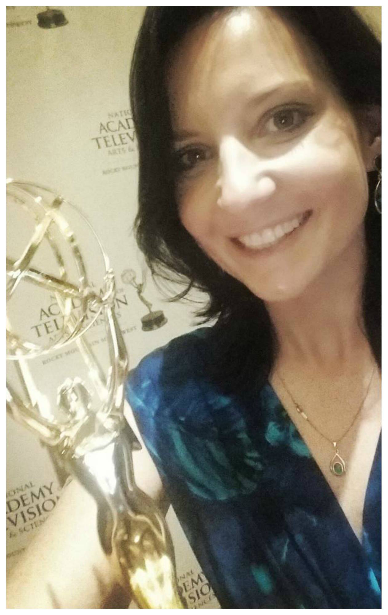 Photo of Anna Augustowska with her Emmy Award