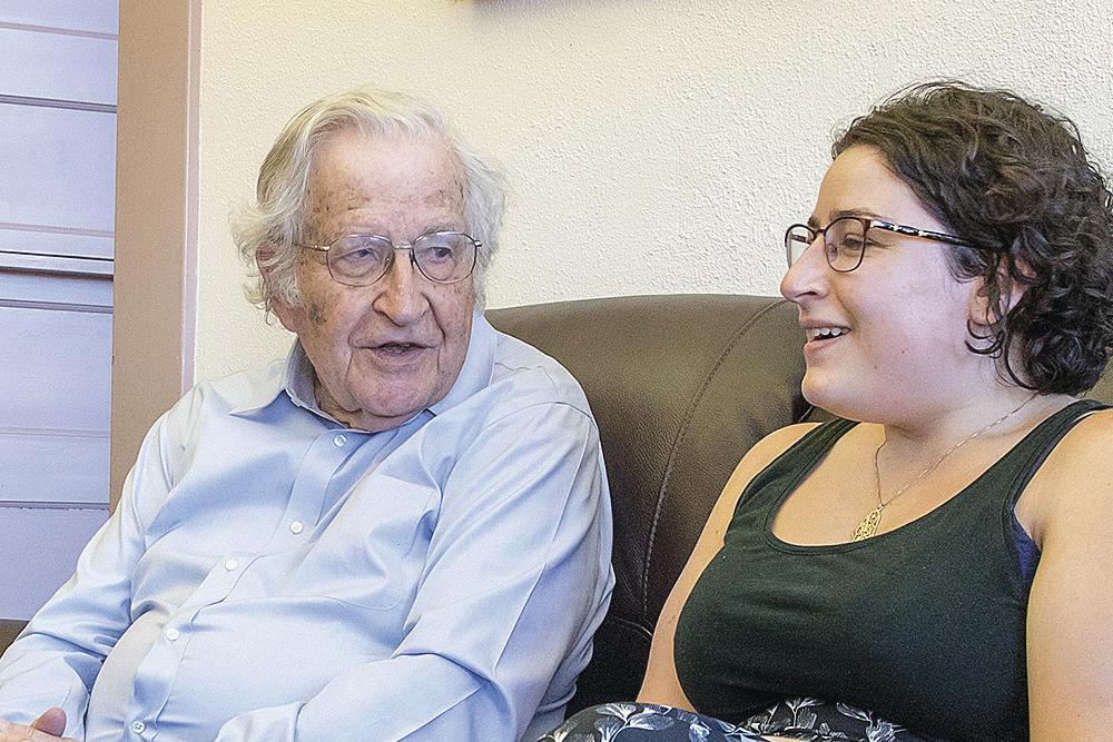 Graduate student chatting with UA Professor Noam Chomsky