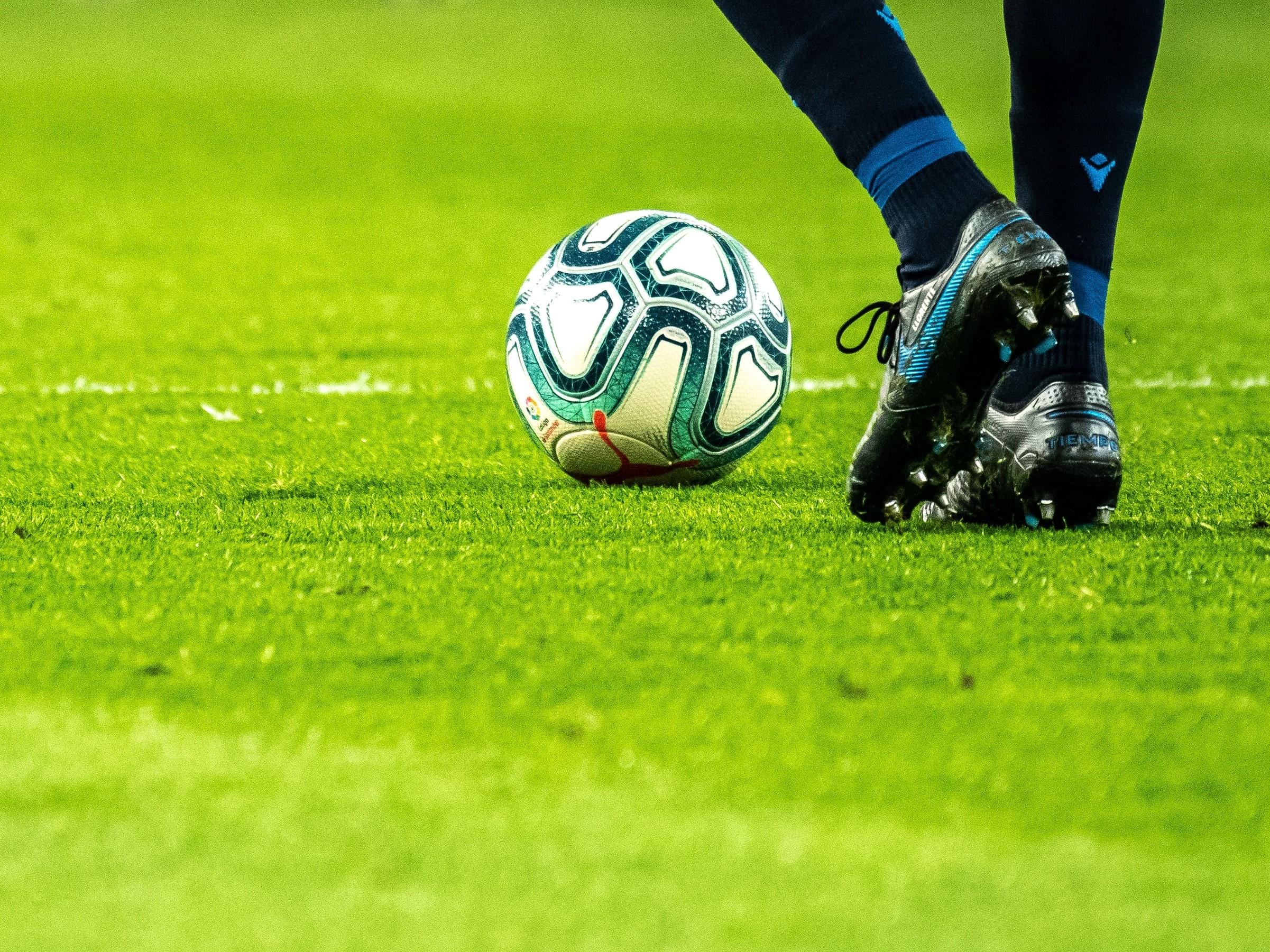 feet and soccer ball