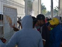 Migrants looking at maps of Mexico