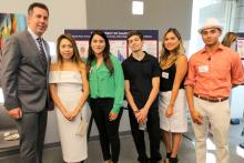 Brian Mayer (left) with students in the Poverty Workshop.