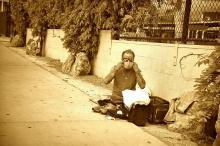 homeless man with mask