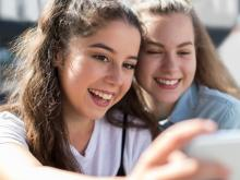 two teen girl taking a selfie