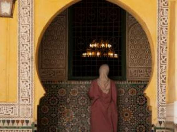 Woman in front of mosque