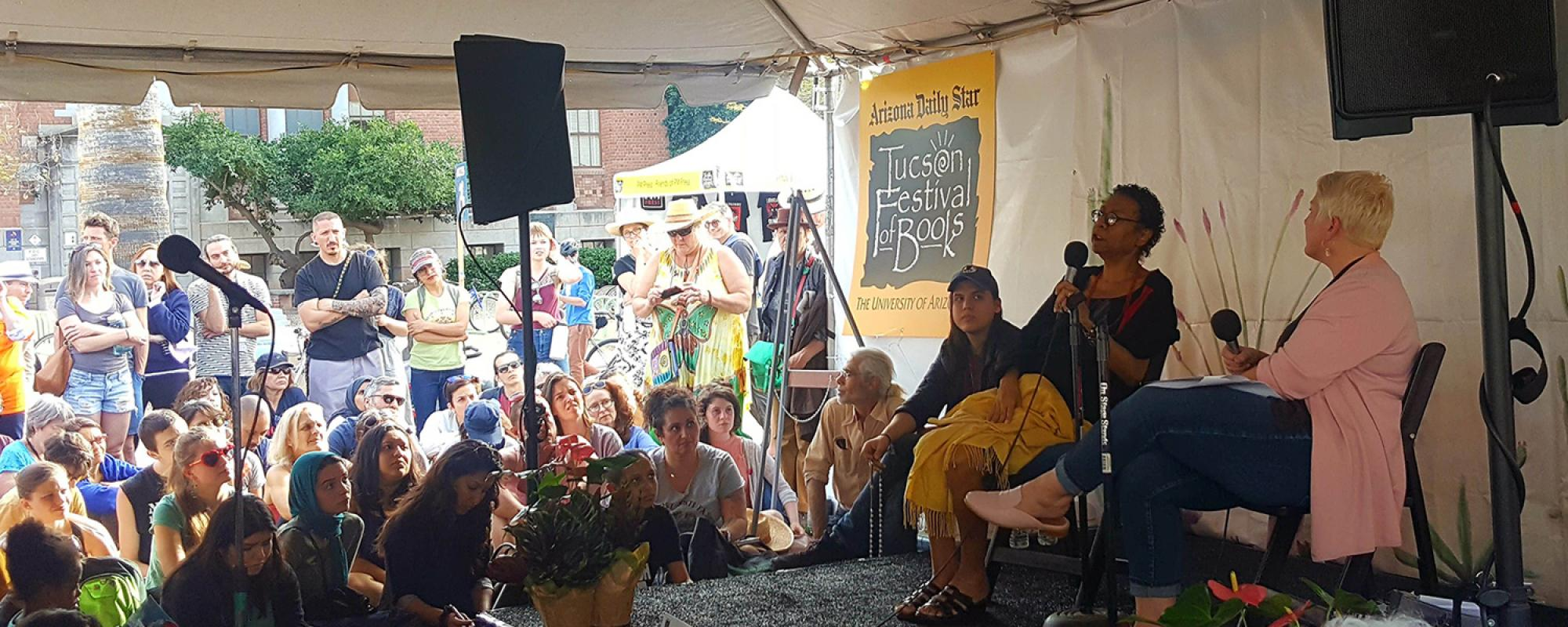 Speakers and audience in the SBS tent at the Tucson Festival of Books