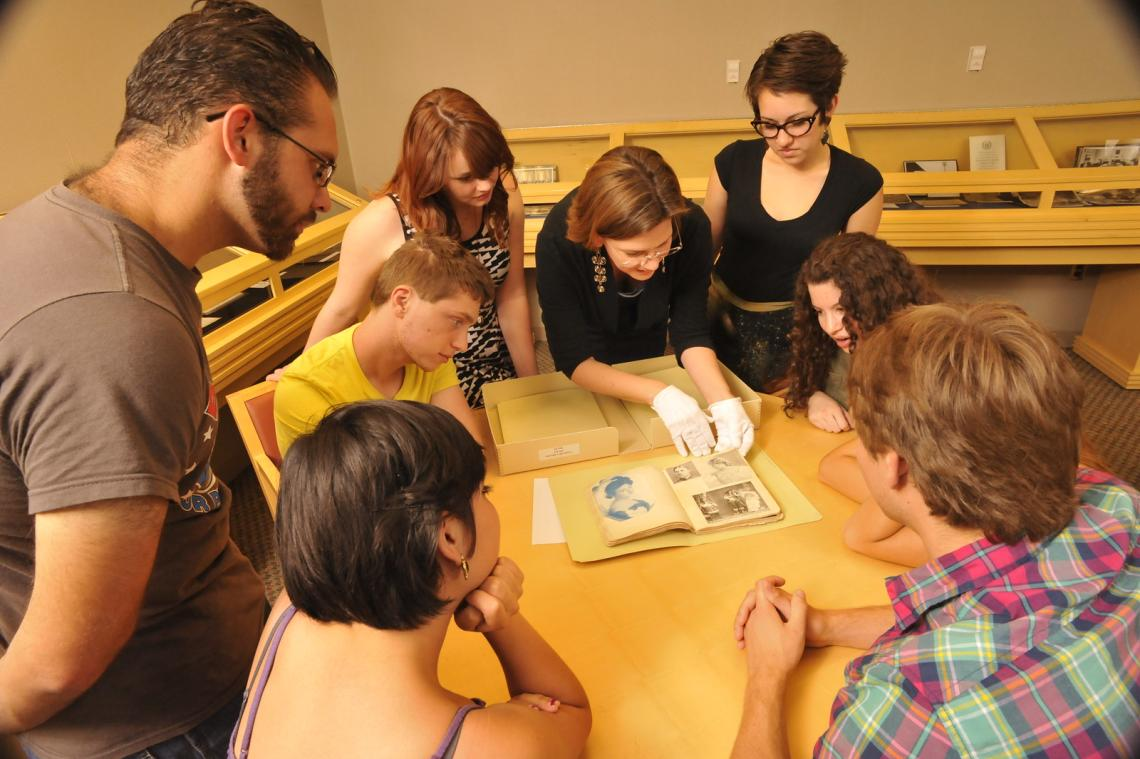Students in a history class looking at archival materials