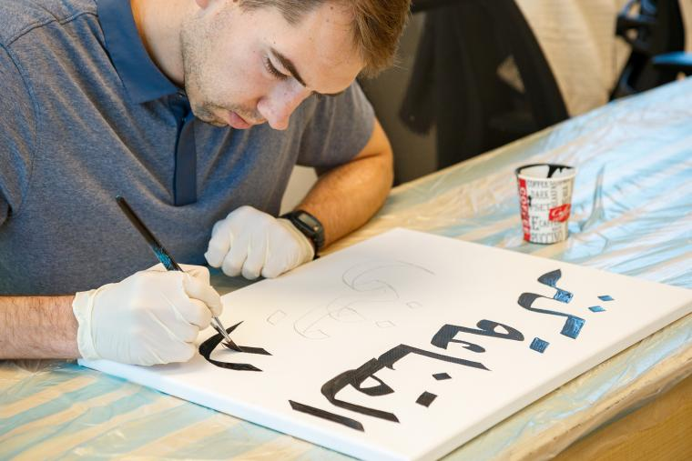 A CASA fellow in Amman at a calligraphy workshop.