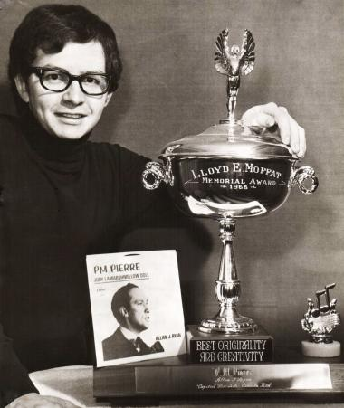 """Professor Allan Ryan with his Moffat trophy and 45 rpm record of """"PM Pierre."""""""