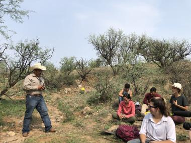 2021 SFSW Fellows learn from a rancher about erosion prevention and sustainable agriculture.