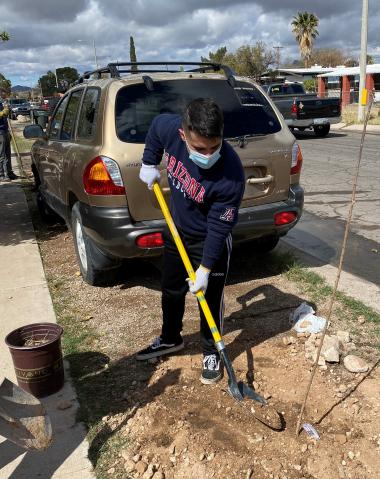 Patrick Robles planted trees in South Tucson as part of the Trees for Tucson project.