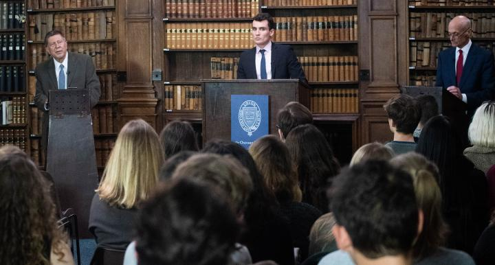 UA historian David Gibbs (at left) debated Michael Chertoff, former Secretary of Homeland Security, at Oxford Union on March 4, 2019, about humanitarian intervention.