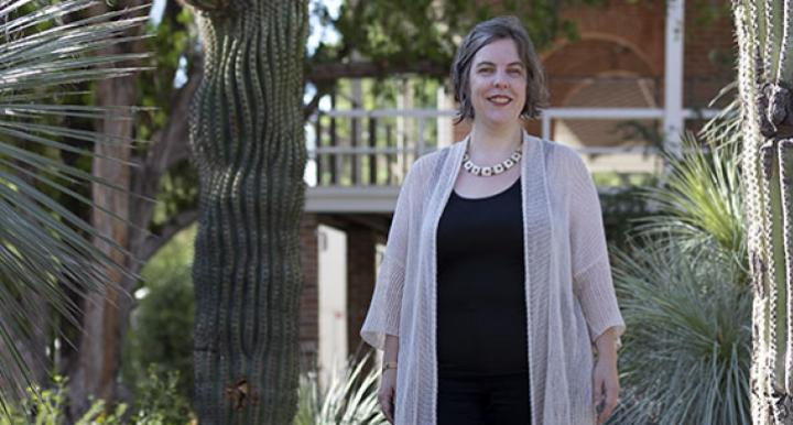Elizabeth Baldwin at the University of Arizona campus by a sagauro.