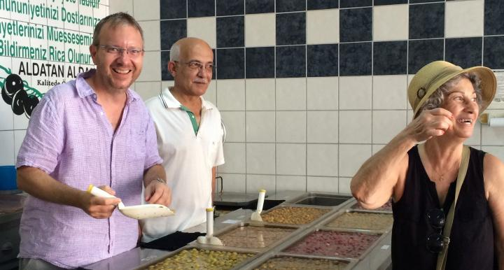 Brian Silverstine in Turkey ladeling soup with two other people